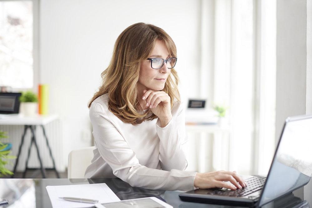 Lady looking at computer